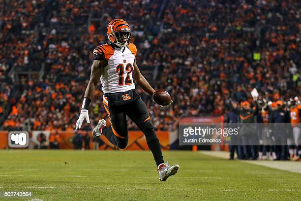 Wide receiver Mohamed Sanu of the Cincinnati Bengals rushes for a touchdown after taking a direct snap at the 6yard line in the second quarter of a...