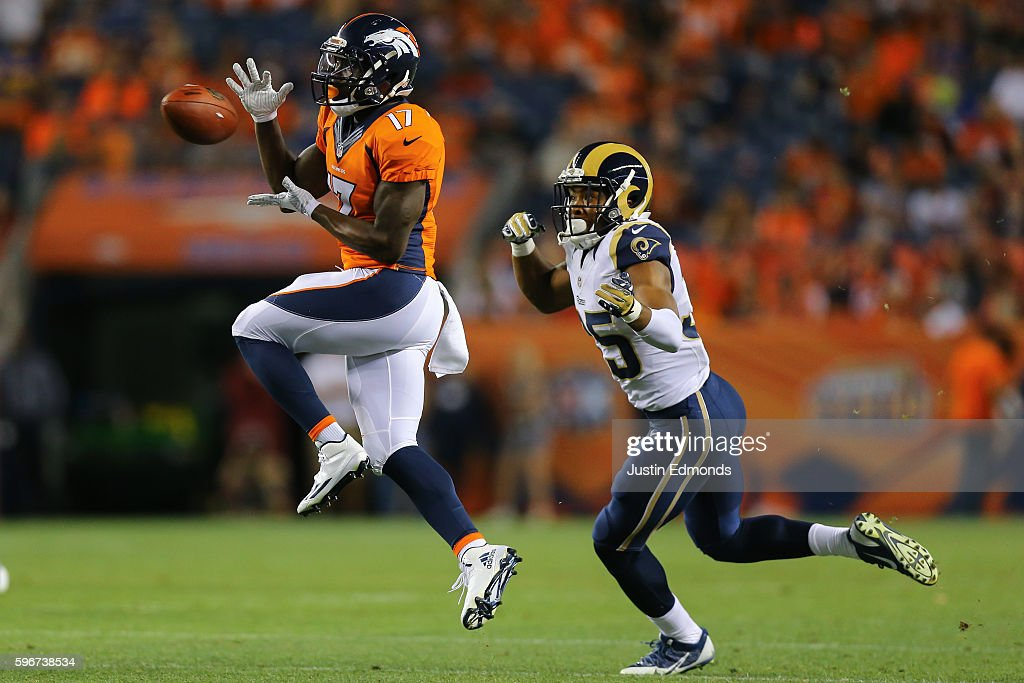 Wide receiver Mose Frazier #17 of the Denver Broncos makes a catch for a first down before getting tackled by defensive back Michael Jordan #35 of the Los Angeles Rams during the fourth quarter at Sports Authority Field at Mile High on August 27, 2016 in Denver, Colorado. The Broncos defeated the Rams 17-9 in pre-season action.