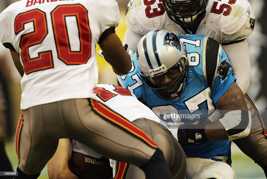 Wide Receiver Muhsin Muhammad #87 of the Carolina Panthers is tackled by Linebacker Shelton Quarles #53 of the Tampa Bay Buccaneers during the NFL game at Ericsson Stadium on October 27, 2002 in Charlotte, North Carolina. The Buccaneers won 12-9.