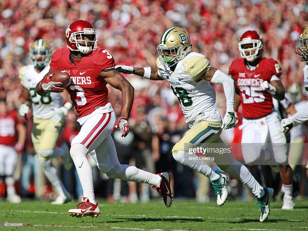Wide receiver Mykel Jones #3 of the Oklahoma Sooners looks back at defensive back Travon Blanchard #48 of the Baylor Bears November 12, 2016 at Gaylord Family-Oklahoma Memorial Stadium in Norman, Oklahoma. Oklahoma defeated Baylor 45-24.