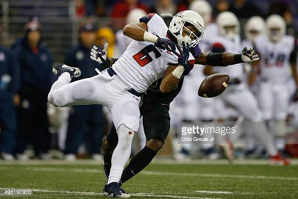 Wide receiver Nate Phillips of the Arizona Wildcats can't make this catch against defensive back Budda Baker of the Washington Huskies on October 31...