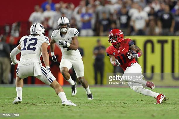 Wide receiver Nate Phillips of the Arizona Wildcats runs with the football after a reception against the Brigham Young Cougars during the college...