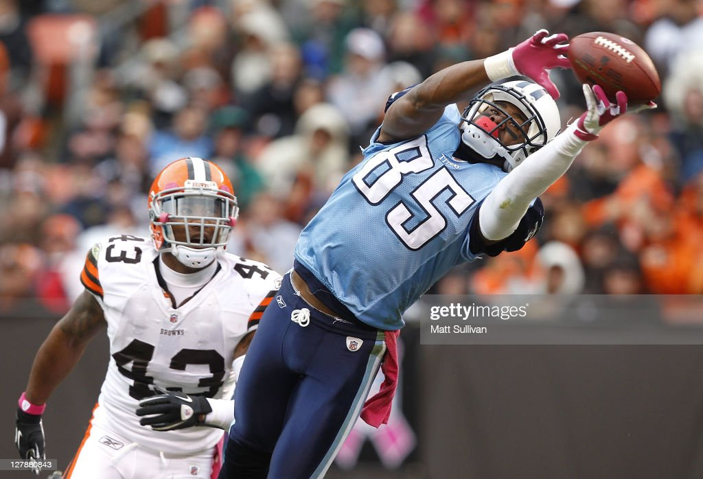 Wide receiver <a gi-track='captionPersonalityLinkClicked' href=/galleries/search?phrase=Nate+Washington&family=editorial&specificpeople=748657 ng-click='$event.stopPropagation()'>Nate Washington</a> #85 of the Tennessee Titans makes a catch in front of defensive back <a gi-track='captionPersonalityLinkClicked' href=/galleries/search?phrase=T.J.+Ward&family=editorial&specificpeople=4640262 ng-click='$event.stopPropagation()'>T.J. Ward</a> #43 of the Cleveland Browns at Cleveland Browns Stadium on October 2, 2011 in Cleveland, Ohio.