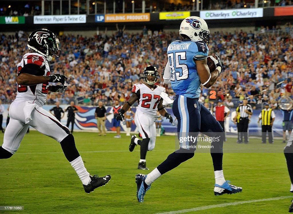 Wide receiver <a gi-track='captionPersonalityLinkClicked' href=/galleries/search?phrase=Nate+Washington&family=editorial&specificpeople=748657 ng-click='$event.stopPropagation()'>Nate Washington</a> #85 of the Tennessee Titans scores a touchdown against the Atlanta Falconsat LP Field on August 24, 2013 in Nashville, Tennessee.