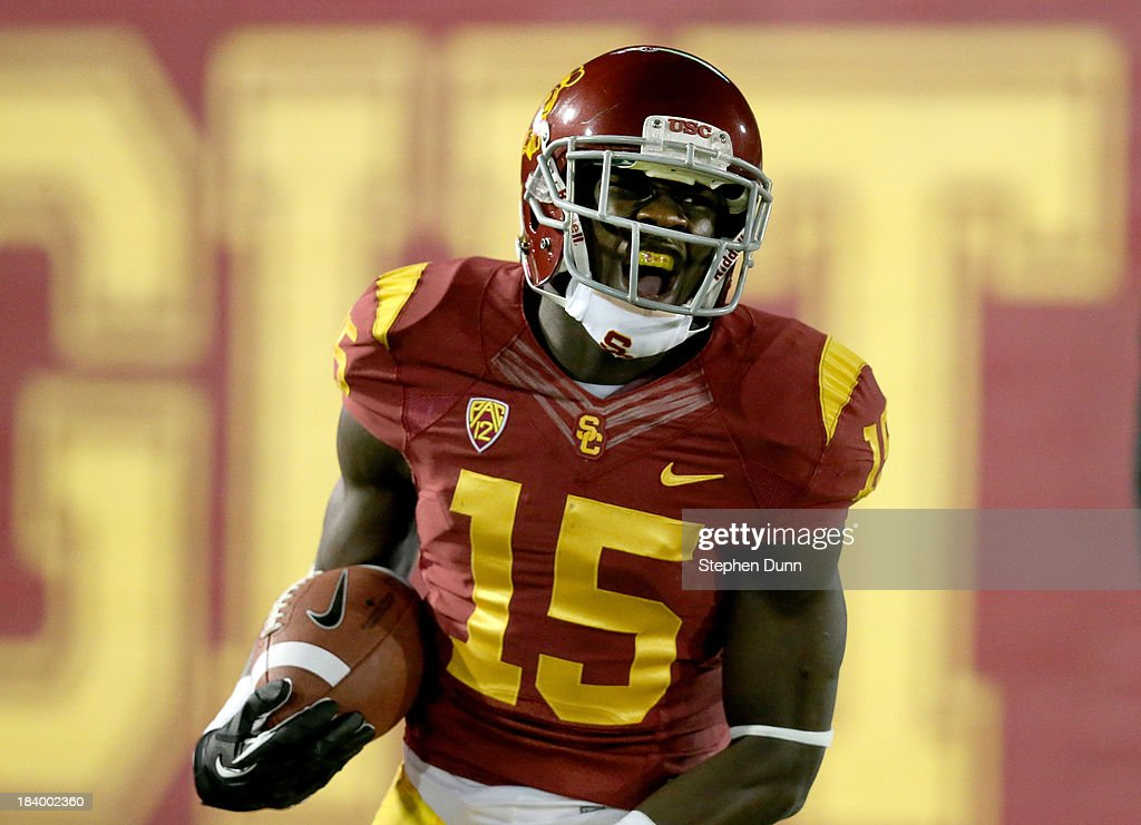 Wide receiver Nelson Agholor #15 of the USC Trojans celebrates after scoring on a 62 yard touchdown pass play in the first quarter against the Arizona Wildcats at Los Angeles Coliseum on October 10, 2013 in Los Angeles, California.