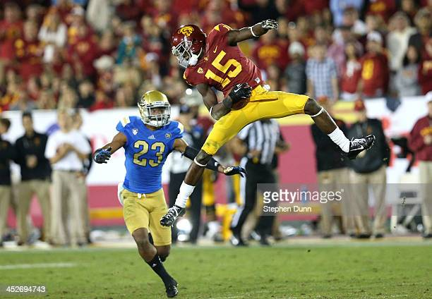 Wide receiver Nelson Agholor of the USC Trojans comes down with a reception in front of safety Anthony Jefferson of the UCLA Bruins at Los Angeles...