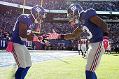 Wide receiver Odell Beckham of the New York Giants celebrates with wide receiver Victor Cruz after scoring a 15 yard touchdown in the fourth quarter...