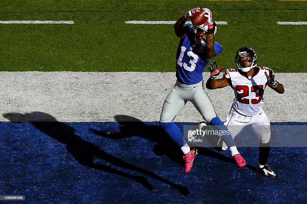 Wide receiver Odell Beckham of the New York Giants scores a 15 yard touchdown in the fourth quarter against cornerback Robert Alford of the Atlanta...