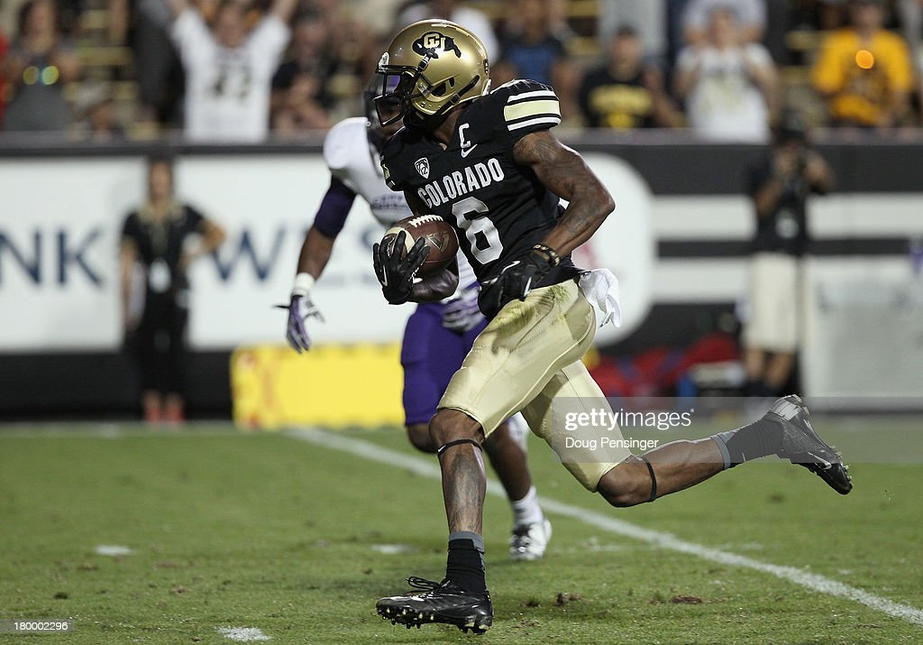 Wide receiver Paul Richardson #6 of the Colorado Buffaloes makes a 30 yard touchdown reception to give the Buffs a 31-24 lead over the Central Arkansas Bears in the fourth quarter at Folsom Field on September 7, 2013 in Boulder, Colorado. The Buffaloes defeated the Bears 38-24.