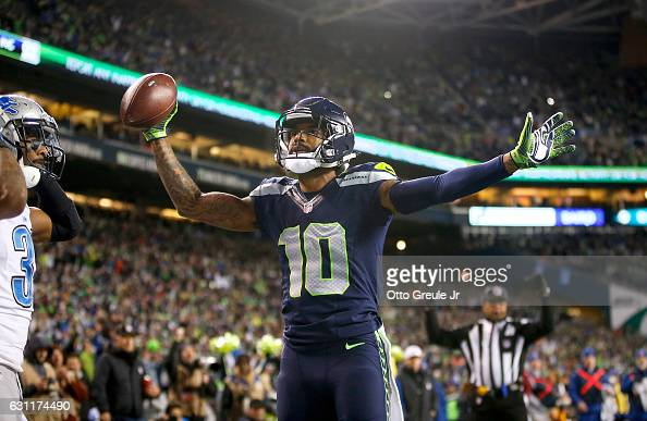 Wide receiver Paul Richardson of the Seattle Seahawks celebrates after making a onehanded touchdown catch against the Detroit Lions in the NFC Wild...