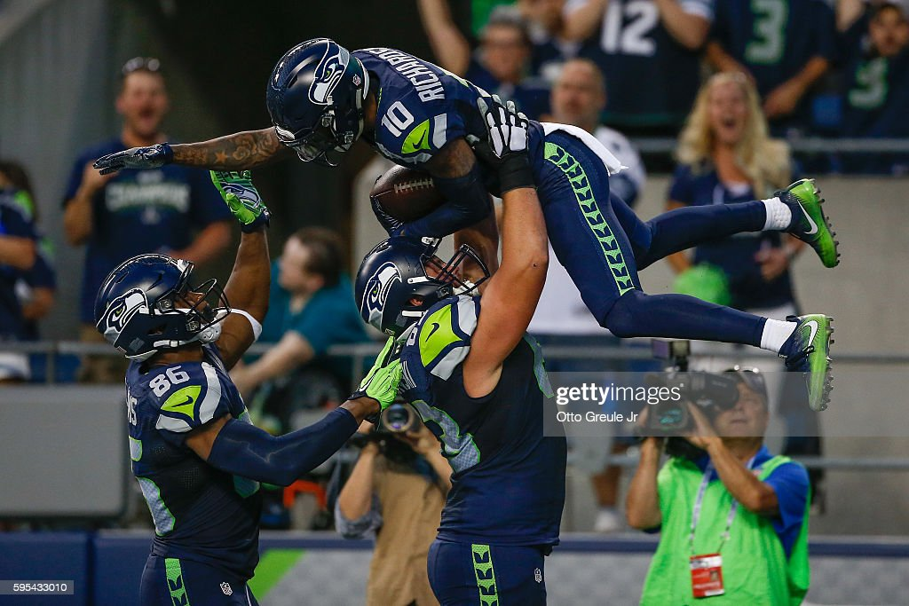 Wide receiver Paul Richardson #10 of the Seattle Seahawks is congratulated by teammates after scoring a touchdown against the Dallas Cowboys during a preseason game at CenturyLink Field on August 25, 2016 in Seattle, Washington.