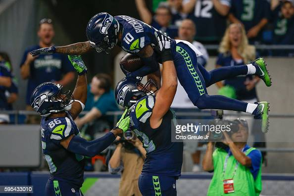 Wide receiver Paul Richardson of the Seattle Seahawks is congratulated by teammates after scoring a touchdown against the Dallas Cowboys during a...