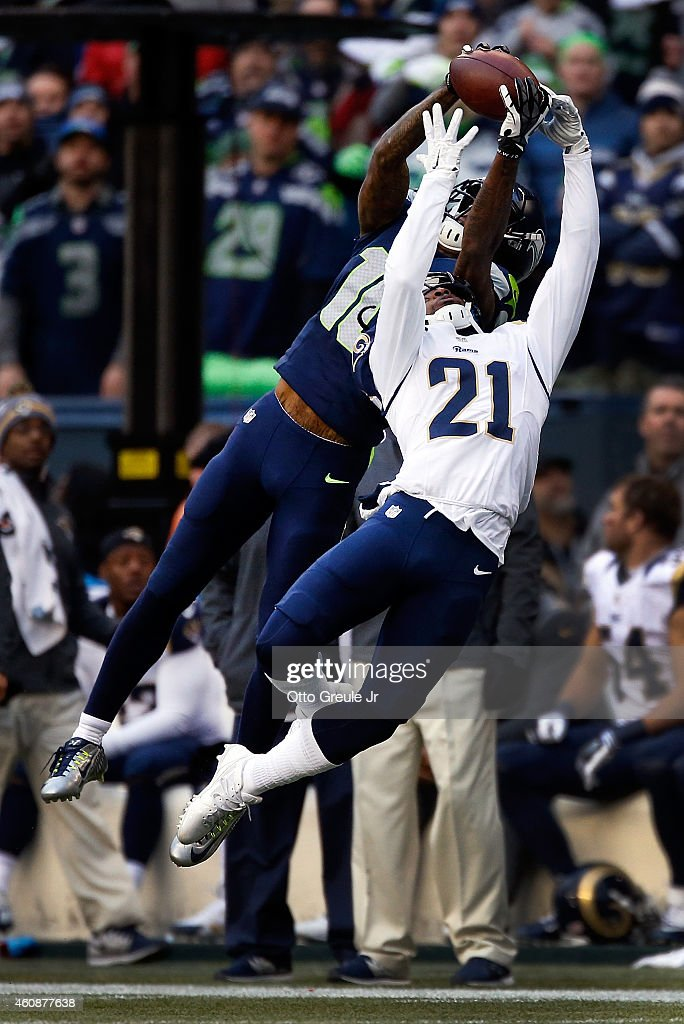 Wide receiver Paul Richardson #10 of the Seattle Seahawks makes a catch over cornerback Janoris Jenkins #21 of the St. Louis Rams during the second quarter of the game at CenturyLink Field on December 28, 2014 in Seattle, Washington.
