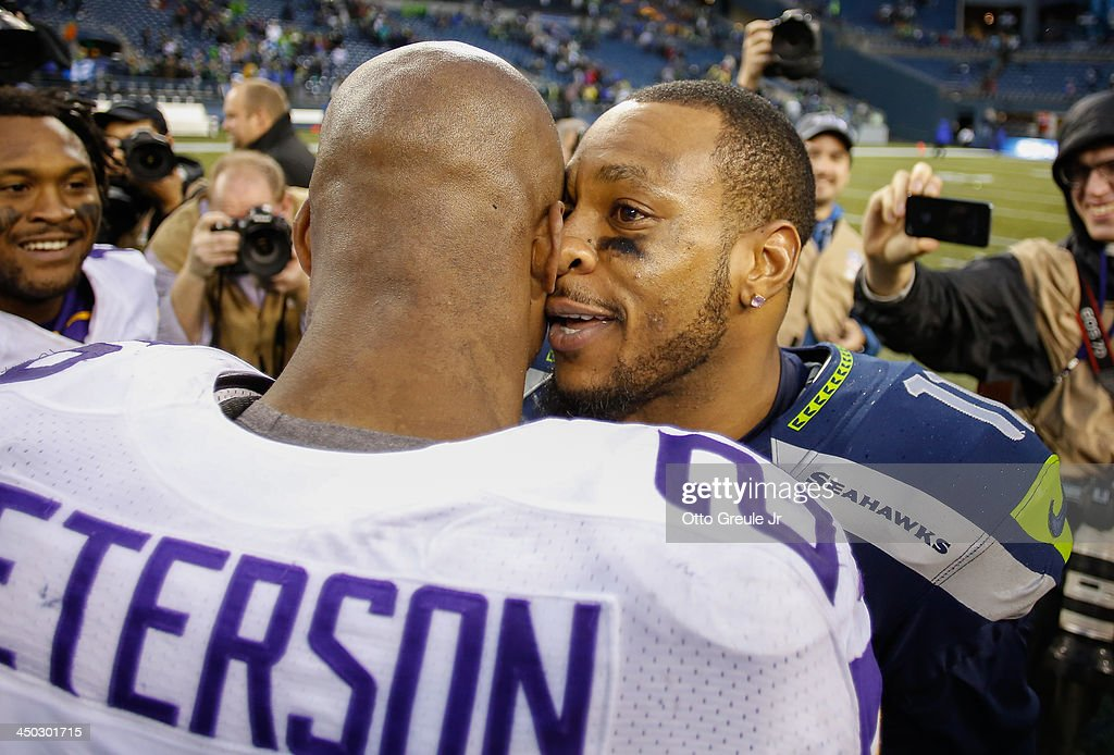 Wide receiver <a gi-track='captionPersonalityLinkClicked' href=/galleries/search?phrase=Percy+Harvin&family=editorial&specificpeople=3061663 ng-click='$event.stopPropagation()'>Percy Harvin</a> #11 of the Seattle Seahawks (R) is greeted by running back <a gi-track='captionPersonalityLinkClicked' href=/galleries/search?phrase=Adrian+Peterson+-+American+Football+Player+-+Minnesota+Vikings&family=editorial&specificpeople=210807 ng-click='$event.stopPropagation()'>Adrian Peterson</a> #28 of the Minnesota Vikings after the Seahawks defeated the Vikings 41-20 at CenturyLink Field on November 17, 2013 in Seattle, Washington.