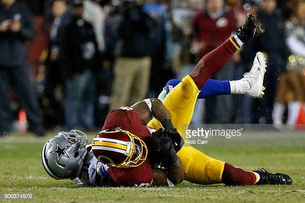 Wide receiver Pierre Garcon of the Washington Redskins catches the ball past free safety Byron Jones of the Dallas Cowboys in the second quarter at...