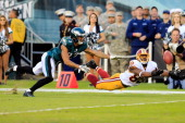 Wide receiver Pierre Garcon of the Washington Redskins reaches for an incomplete pass while being defended by free safety Patrick Chung of the...