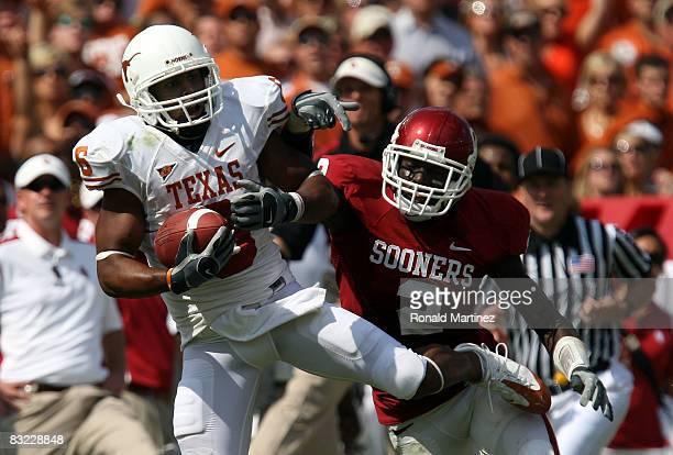 Wide receiver Quan Cosby the Texas Longhorns makes a pass reception against Brian Jackson of the Oklahoma Sooners during the Red River Rivalry at the...