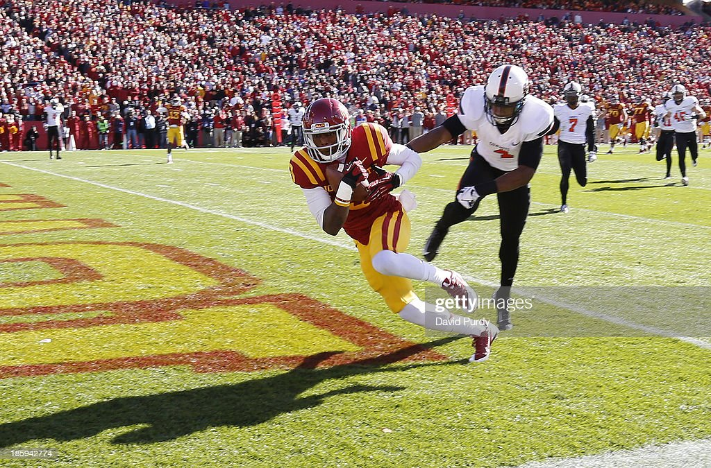 Wide receiver Quenton Bundrage #9 of the Iowa State Cyclones pulls in a pass in the end zone for a touchdown as cornerback Justin Gilbert #4 of the Oklahoma State Cowboys defends in the first half of play at Jack Trice Stadium on October 26, 2013 in Ames, Iowa.