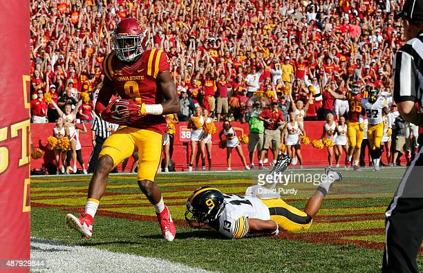 Wide receiver Quenton Bundrage of the Iowa State Cyclones scores a touchdown as defensive back Greg Mabin of the Iowa Hawkeyes defends in the first...