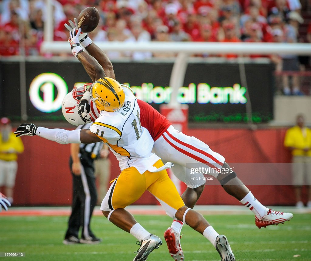 Wide receiver Quincy Enunwa #18 of the Nebraska Cornhuskers fights for a ball with defensive back Kalan Reed #11 of the Southern Miss Golden Eagles during their game at Memorial Stadium on September 7, 2013 in Lincoln, Nebraska.