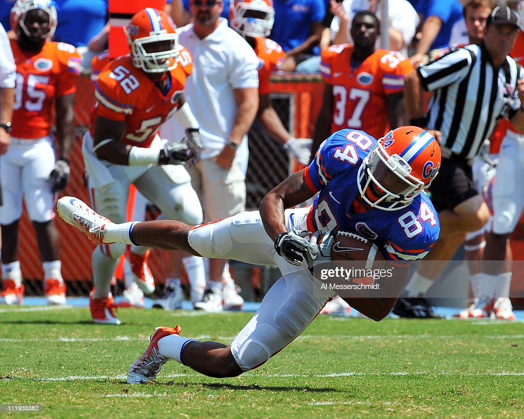 Wide receiver Quinton Dunbar #84 of the Florida Gators grabs a midfield pass during the Orange and Blue spring football game April 9, 2010 Ben Hill Griffin Stadium in Gainesville, Florida.