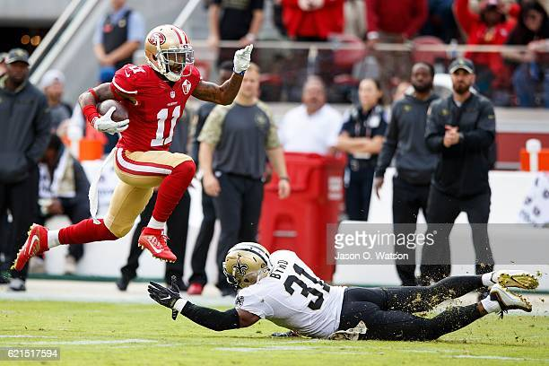 Wide receiver Quinton Patton of the San Francisco 49ers breaks a tackle from free safety Jairus Byrd of the New Orleans Saints during the first...