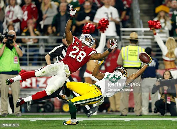 Wide receiver Randall Cobb of the Green Bay Packers makes a catch against cornerback Justin Bethel of the Arizona Cardinals but it was called back...