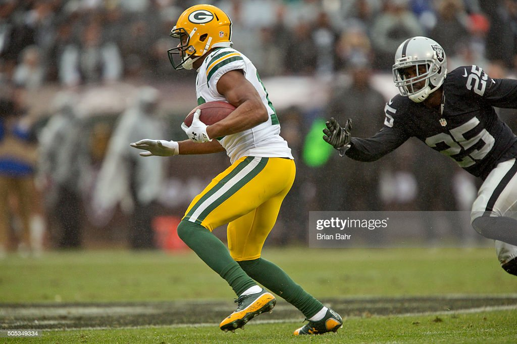 Wide receiver Randall Cobb of the Green Bay Packers picks up 23 yards on a catch against cornerback DJ Hayden of the Oakland Raiders in the second...