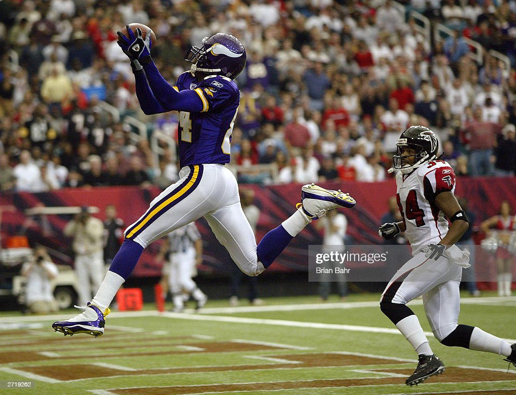 Wide receiver Randy Moss of the Minnesota Vikings goes up to get a touchdown pass over his head against cornerback Ray Buchanan of the Atlanta...