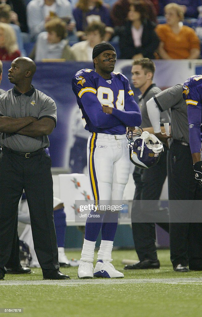 Wide receiver Randy Moss of the Minnesota Vikings stands on the sidelines during the game against the Tennessee Titans at the Hubert H Humphrey...