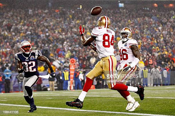 Wide receiver Randy Moss of the San Francisco 49ers catches a pass thrown by quarterback Colin Kaepernick to score a touchdown in the first quarter...