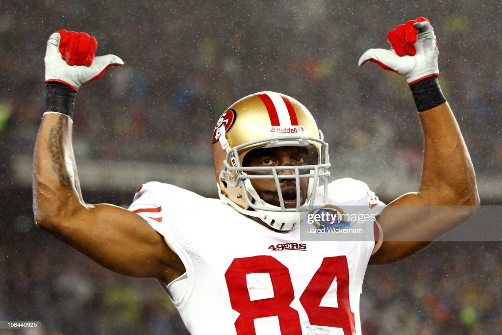 Wide receiver <a gi-track='captionPersonalityLinkClicked' href=/galleries/search?phrase=Randy+Moss&family=editorial&specificpeople=201999 ng-click='$event.stopPropagation()'>Randy Moss</a> #84 of the San Francisco 49ers celebrates after scoring a touchdown passed by quarterback Colin Kaepernick #7 in the first quarter against New England Patriots at Gillette Stadium on December 16, 2012 in Foxboro, Massachusetts.