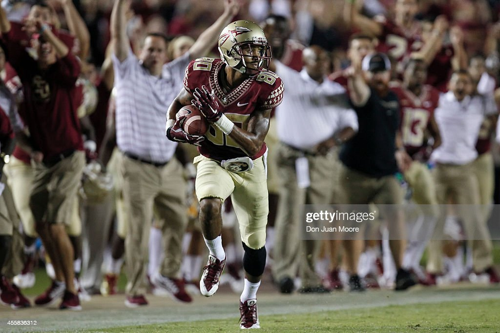 Wide Receiver <a gi-track='captionPersonalityLinkClicked' href=/galleries/search?phrase=Rashad+Greene+-+American+Football+Player&family=editorial&specificpeople=13970375 ng-click='$event.stopPropagation()'>Rashad Greene</a> #80 of the Florida State Seminoles on a pass play for a touchdown during the game against the Clemson Tigers at Doak Campbell Stadium on Bobby Bowden Field on September 20, 2014 in Tallahassee, Florida. The #1 ranked Florida State Seminoles defeated the #22 ranked Clemson Tigers 23 to 17 in overtime.