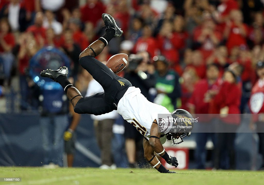 wide receiver Rashad Ross #15 of the Arizona State Sun Devils falls to the grass after unable to catch a long pass during the fourth quarter of the college football game against the Arizona Wildcats at Arizona Stadium on November 23, 2012 in Tucson, Arizona. The Sun Devils defeated the Wildcats 41-34.