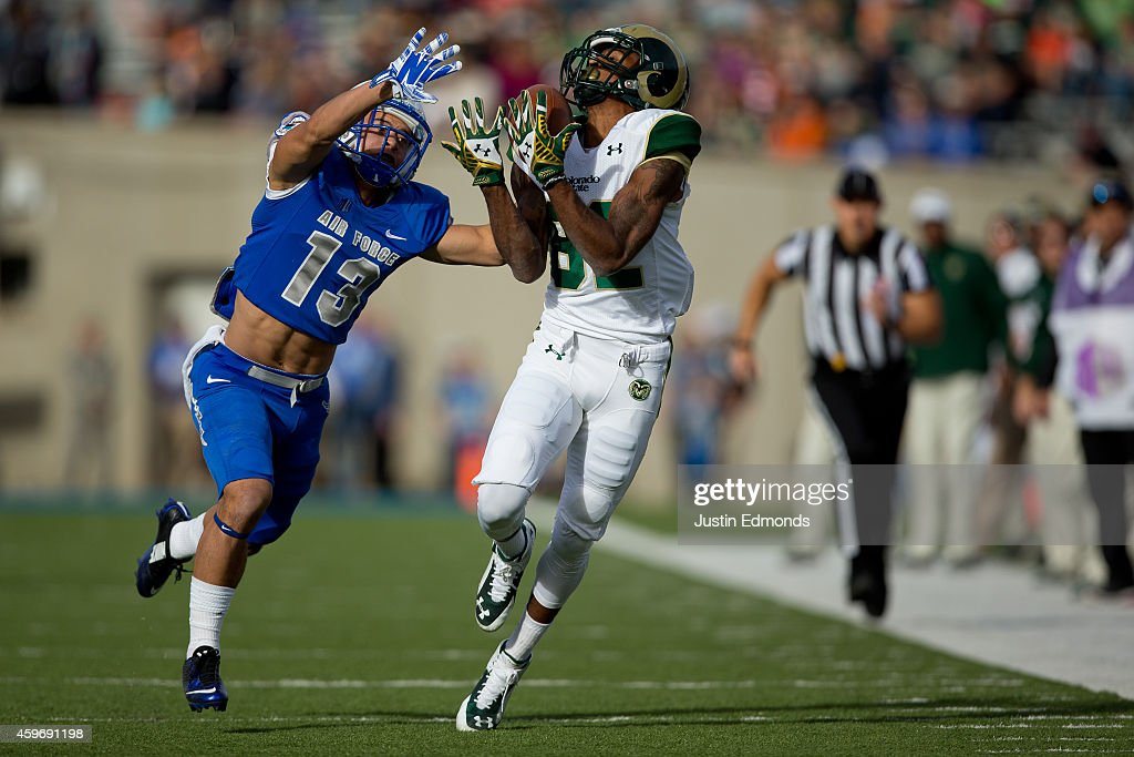 Wide receiver Rashard Higgins of the Colorado State Rams makes a catch for a first down while being defended by defensive back Justin DeCoud of the...