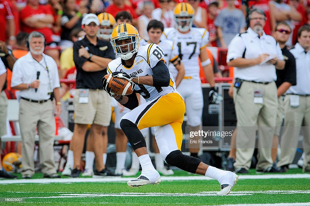 Wide receiver Rickey Bradley #81 of the Southern Miss Golden Eagles catches a pass during their game against the Nebraska Cornhuskers at Memorial Stadium on September 7, 2013 in Lincoln, Nebraska.