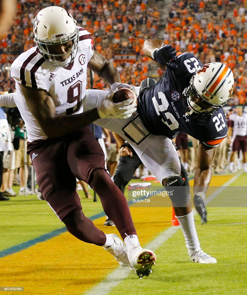 Wide receiver Ricky Seals-Jones #9 of the Texas A&M Aggies catches a pass over defensive back Johnathan Ford #23 of the Auburn Tigers but lands out of bounds during the second half of an NCAA college football game on September 17, 2016 in Auburn, Alabama. Texas A&M Aggies won 29-16.