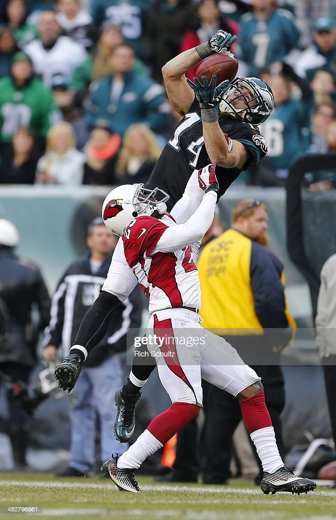Wide receiver <a gi-track='captionPersonalityLinkClicked' href=/galleries/search?phrase=Riley+Cooper&family=editorial&specificpeople=4099675 ng-click='$event.stopPropagation()'>Riley Cooper</a> #14 of the Philadelphia Eagles can't control possession of the ball after being hit by cornerback <a gi-track='captionPersonalityLinkClicked' href=/galleries/search?phrase=Jerraud+Powers&family=editorial&specificpeople=3234010 ng-click='$event.stopPropagation()'>Jerraud Powers</a> #25 of the Arizona Cardinals in the third quarter during a game at Lincoln Financial Field on December 1, 2013 in Philadelphia, Pennsylvania. The Eagles defeated the Cardinals 24-21.