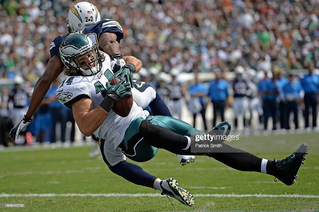 Wide receiver Riley Cooper #14 of the Philadelphia Eagles catches a pass past cornerback Derek Cox #22 of the San Diego Chargers in the second quarter for a touchdown at Lincoln Financial Field on September 15, 2013 in Philadelphia, Pennsylvania.