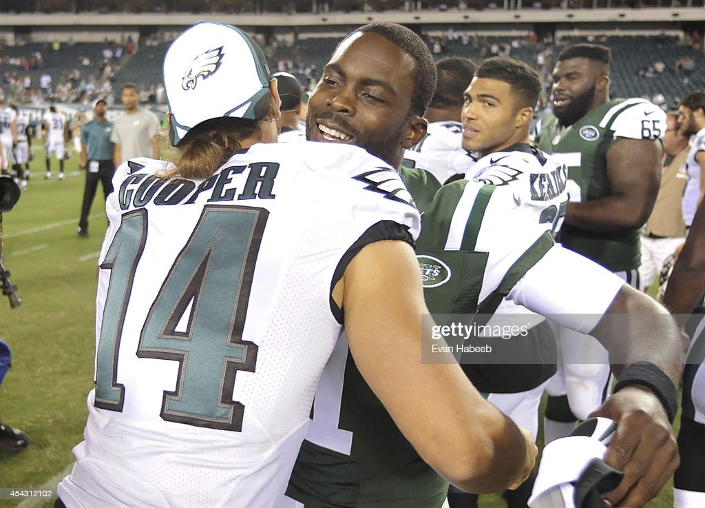 Wide receiver Riley Cooper #14 of the Philadelphia Eagles embraces quarterback Michael Vick #1 of the New York Jets after the Eagles defeated the Jets 37-7 in the final preseason game on August 28, 2014 at Lincoln Financial Field in Philadelphia, Pennsylvania.