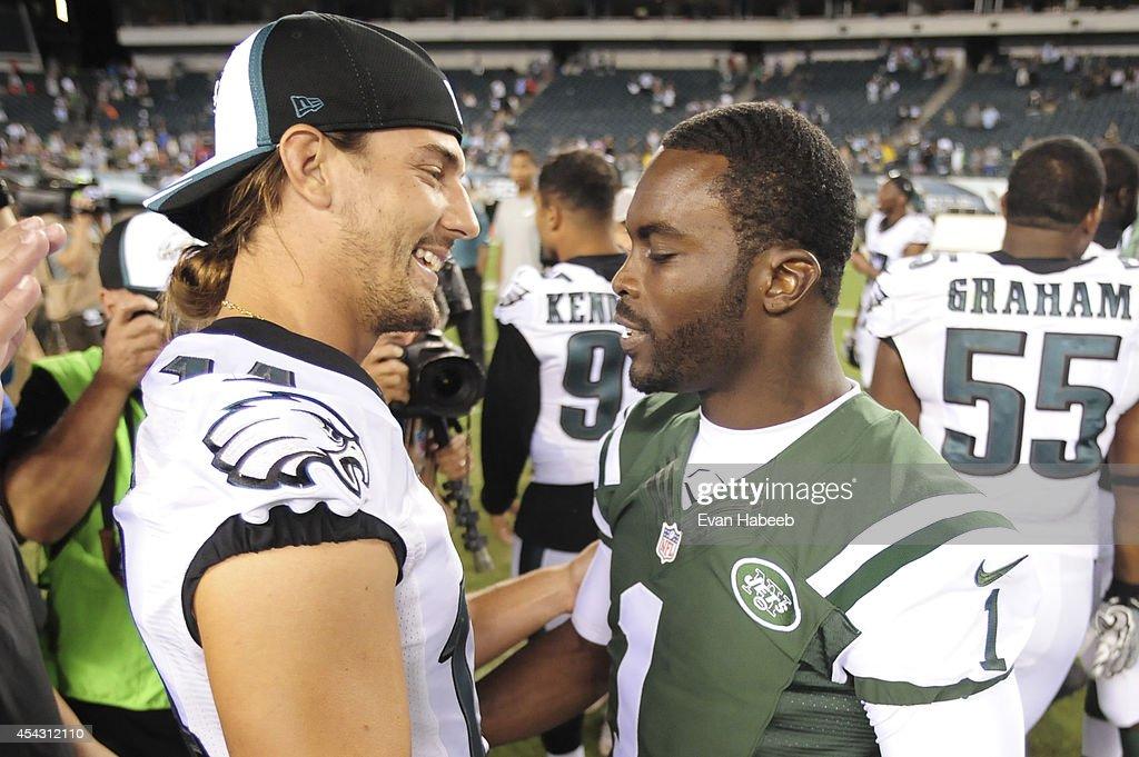 8b91ba82b70 ... Wide receiver Riley Cooper 14 of the Philadelphia Eagles embraces  quarterback Michael Vick ...