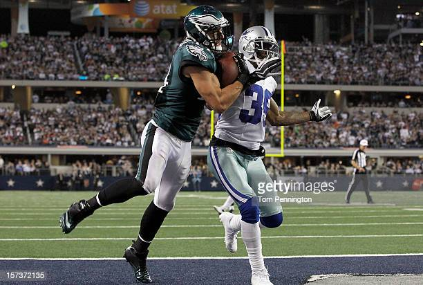 Wide receiver Riley Cooper of the Philadelphia Eagles pulls in a touchdown pass against cornerback Brandon Carr of the Dallas Cowboys to take the...