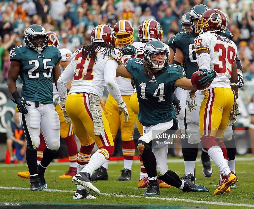 Wide receiver <a gi-track='captionPersonalityLinkClicked' href=/galleries/search?phrase=Riley+Cooper&family=editorial&specificpeople=4099675 ng-click='$event.stopPropagation()'>Riley Cooper</a> #14 of the Philadelphia Eagles reacts after making a catch at the one yard line as safety <a gi-track='captionPersonalityLinkClicked' href=/galleries/search?phrase=Brandon+Meriweather&family=editorial&specificpeople=2109760 ng-click='$event.stopPropagation()'>Brandon Meriweather</a> #31 and cornerback <a gi-track='captionPersonalityLinkClicked' href=/galleries/search?phrase=David+Amerson&family=editorial&specificpeople=7244765 ng-click='$event.stopPropagation()'>David Amerson</a> #39 of the Washington Redskins look on during the third quarter of a game at Lincoln Financial Field on November 17, 2013 in Philadelphia, Pennsylvania. The Eagles defeated the Redskins 24-16.