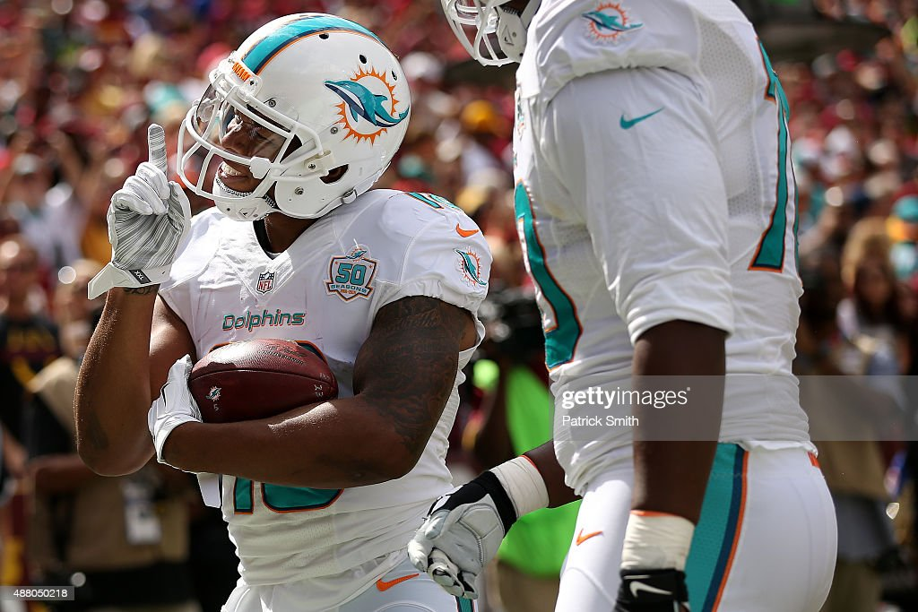 Wide receiver Rishard Matthews of the Miami Dolphins celebrates a first half touchdown during a game against the Washington Redskins at FedExField on...