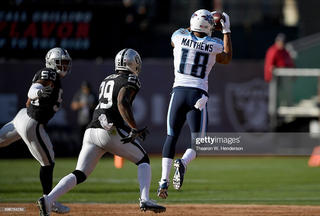 Wide receiver Rishard Matthews #18 of the Tennessee Titans catches a pass in front of cornerback David Amerson #29 of the Oakland Raiders in the first half of their preseason football game at the Oakland Coliseum on August 27, 2016 in Oakland, California.