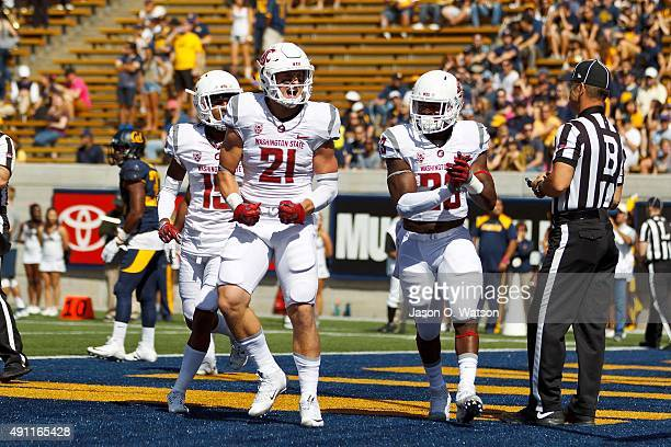 Wide receiver River Cracraft of the Washington State Cougars celebrates after scoring a touchdown against the California Golden Bears during the...