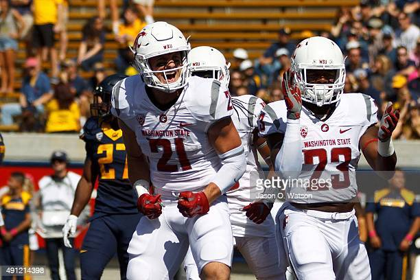 Wide receiver River Cracraft of the Washington State Cougars celebrates after scoring a touchdown during the first quarter at California Memorial...