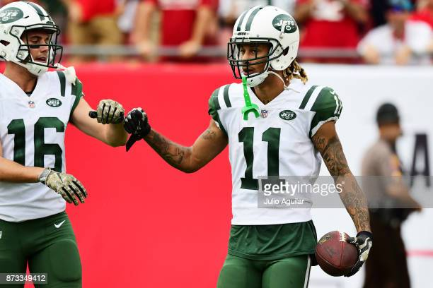 Wide receiver Robby Anderson of the New York Jets celebrates after scoring a touchdown against the Tampa Bay Buccaneers late in the fourth quarter on...