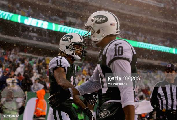 Wide receiver Robby Anderson of the New York Jets celebrates scoring a touchdown with teammate wide receiver Jermaine Kearse against the Atlanta...
