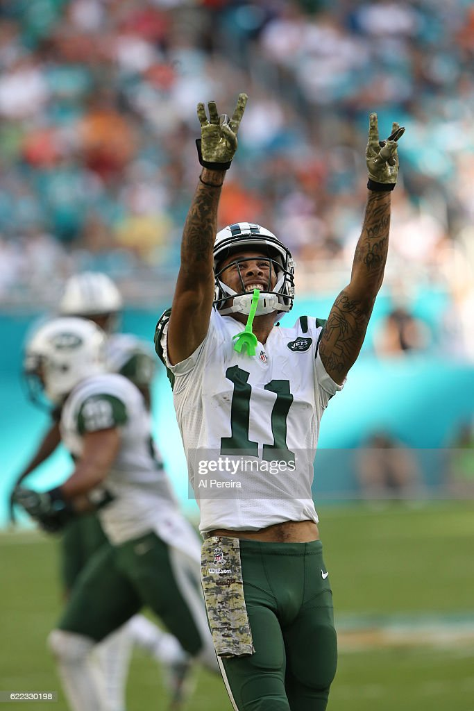 Wide Receiver Robby Anderson #11 of the New York Jets has a big catch and celebrates against the Miami Dolphins on November 6, 2016 at Hard Rock Stadium in Miami Gardens, Florida. The Dolphins defeated the Jets 27-23.